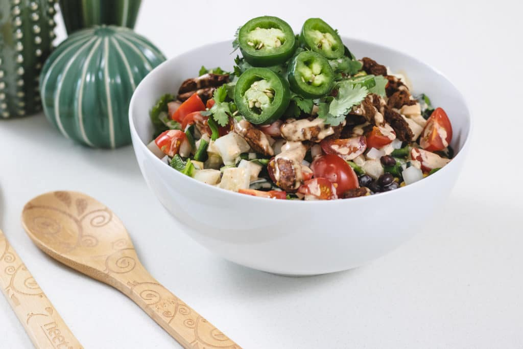 Fiesta Salad in a bowl with jalapeno toppings